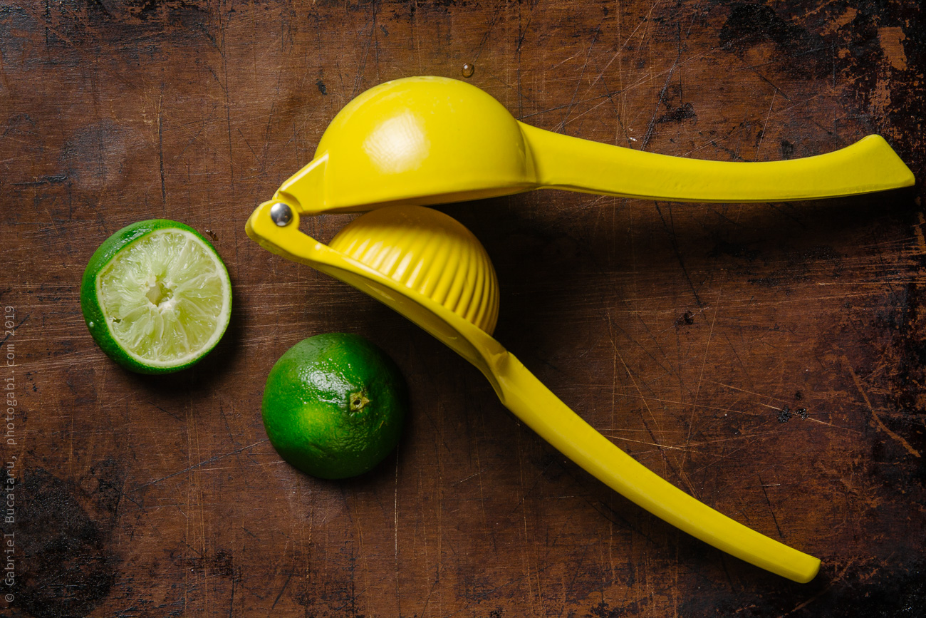 Lime halves and a yellow squeezer